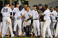 Tampa Yankees second baseman Nick Solak (39) is mobbed by teammates, including Matt Snyder (29), Sharif Othman (62), and Jorge Mateo (14), after a walk off base hit during a game against the Fort Myers Miracle on April 12, 2017 at George M. Steinbrenner Field in Tampa, Florida.  Tampa defeated Fort Myers 3-2.  (Mike Janes/Four Seam Images)