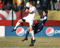 Taylor Kemp #2 of the University of Maryland heads away from Hamoody Saad #17 of the University of Michigan during an NCAA quarter-final match at Ludwig Field, University of Maryland, College Park, Maryland on December 4 2010.Michigan won 3-2 AET.