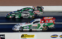 Apr 7, 2006; Las Vegas, NV, USA; NHRA Funny Car driver Ron Capps in the Brute Dodge Stratus leads John Force driving the Castrol GTX Ford Mustang during qualifying for the Summitracing.com Nationals at Las Vegas Motor Speedway in Las Vegas, NV. Mandatory Credit: Mark J. Rebilas