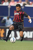 Amado Guevara opened the scoring in the 7th minute with this shot from a pass by Clint Mathis. The San Jose Earthquakes and the the NY/NJ MetroStars played to a 4-4 tie on 7/02/03 at Giant's Stadium, NJ..
