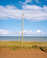 A simple telegraph pole looks out to sea. <br /> Prince Edward Island has a unique place in telecommunications history. In 1852, Frederic Newton Gisborne laid the first ocean cable on this side of the Atlantic, connecting Carleton Head, Prince Edward Island with Cape Tormentine, New Brunswick, a distance of 14 miles by water. This cable was used for telegraphy. This submarine cable was the first in North America and preceded the line to Newfoundland and then to England by four years.