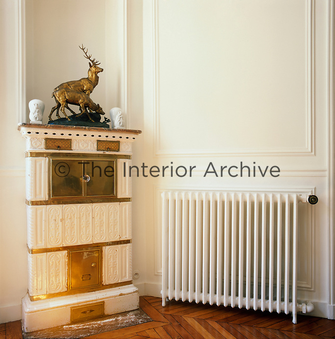 A Swedish ceramic stove contrasts with a modern radiator in this corner of the living room