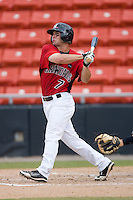 Cody Podraza #7 of the Hickory Crawdads follows through on his swing versus the West Virginia Power at L.P. Frans Stadium August 9, 2009 in Hickory, North Carolina. (Photo by Brian Westerholt / Four Seam Images)