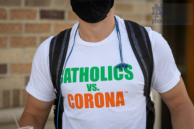 """September 2, 2020; Student with a """"Catholics vs. Corona"""" t-shirt outside Duncan Student Center on the first day of resumed in-person classes of the fall semester 2020. (Photo by Matt Cashore/University of Notre Dame)"""