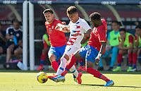CARSON, CA - FEBRUARY 1: Ulysses Llanez Jr #19  of the United States moves with the ball past Keysher Fuller #4 and Yeltsin Tejeda #17 of Costa Rica during a game between Costa Rica and USMNT at Dignity Health Sports Park on February 1, 2020 in Carson, California.