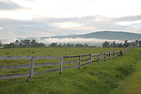Long classic fence on a farm in front of the Blue Ridge mountains  in Albemarle County, VA.