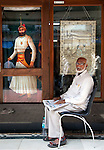 MUMBAI, INDIA - SEPTEMBER 27, 2010: An old man sits outside one of the many antiques shops on Mutton Street at Chor Bazaar in the Muslim quarter of Mumbai. The Taj Mahal Palace and Tower Hotel has re-opened after the terror attacks of 2008 destroyed much of the heritage wing. The wing has been renovated and the hotel is once again the shining jewel of Mumbai. pic Graham Crouch