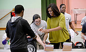 First Lady Michelle Obama participates in a community service project at Leckie Elementary school in celebration of the Martin Luther King, Jr. Day of Service and in honor of Dr. King's life and legacy on January 18, 2016 in Washington, DC. The President and the First Lady are participating in a community service project at Leckie Elementary School in Washington, DC in celebration of the Martin Luther King, Jr. Day of Service and in honor of Dr. King's life and legacy. The President and First Lady are joined by White House mentees as well as members of AmeriCorps in volunteering with students at Leckie, a high proportion of whom come from military families.<br /> Credit: Olivier Douliery / Pool via CNP