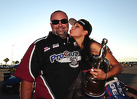 Oct. 30, 2011; Las Vegas, NV, USA: NHRA pro mod driver Leah Pruett (right) celebrates with crew chief Steve Petty after winning the Big O Tires Nationals at The Strip at Las Vegas Motor Speedway. Mandatory Credit: Mark J. Rebilas-
