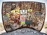 Graffiti on abandoned and rusty water tank, Salisbury Wash, Nev.