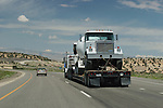 A truck with another truck as cargo at Interstate 79 at Cisco, Utha, USA