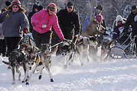 Sunday February 27, 2010   Dog handlers help bring Anitra Winkler's dogs to the start line of the Junior Iditarod at Willow Lake , Alaska