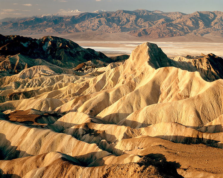 Sunrise light on Manly Beacon and the Panamint Range viewed from Zabriskie Point; Death Valley National Park ,CA