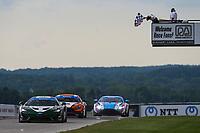 #3 Motorsports In Action McLaren 570S GT4, GS: Sheena Monk, Corey Lewis, Checkered Flag