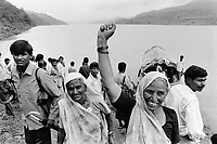 India, Narmada River, Narmada dams and protest movement of NBA Narmada Bachao Andolan, movement to save the Narmada river, and affected Adivasi in their villages, tribal village Domkhedi, rally in September 2000, Adivsi women welcome Medha Patkar and Arundhati Roy