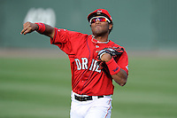 Infielder/second baseman Wendell Rijo (11) of the Greenville Drive on the team's preseason workout one day before Opening Day on Wednesday, April 2, 2014, at Fluor Field at the West End in Greenville, South Carolina. Rijo is the Boston Red Sox No. 18 prospect, according to Baseball America. (Tom Priddy/Four Seam Images)