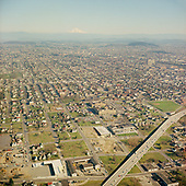Y-680228B-07.  Aerial view of Emanuel Hospital and the heart of the Black business district in inner N and NE Portland, Oregon. Most of this was demolished for a proposed hospital expansion, which lost its funding. February 28, 1968. Fremont Bridge exit ramp lower left.