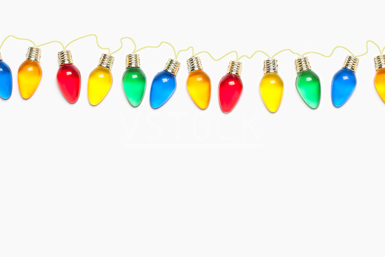 USA, Illinois, Metamora, colorful Christmas lights on white background