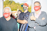 "People wear Trump 2020 facemasks and ""Keep America Great"" hats during a Trump campaign office opening party in Salem, New Hampshire, on Fri., Sept. 18, 2020. Former 2016 Trump campaign manager and current 2020 Trump campaign senior advisor Corey Lewandowski, lives in nearby Windham, NH, spoke at the event, which also doubled as a surprise birthday celebration for Lewandowski."
