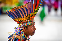 """A Colombian Kamentsá native, wearing a colorful feather headgear, takes part in the Carnival of Forgiveness, a traditional indigenous celebration in Sibundoy, Colombia, 12 February 2013. Clestrinye (""""Carnaval del Perdón"""") is a ritual ceremony kept for centuries in the Valley of Sibundoy in Putumayo (the Amazonian department of Colombia), a home to two closely allied indigenous groups, the Inga and Kamentsá. Although the festival has indigenous origins, the Catholic religion elements have been introduced and merged with the shamanistic tradition. Celebrating annually the collaboration, peace and unity between tribes, they believe that anyone who offended anyone may ask for forgiveness this day and all of them should grant pardons."""