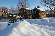 """Hartwell Tavern along the Battle Road at Minute Man National Historical Park in Lincoln, Massachusetts during the winter months. This is a restored 18th-century home and tavern. Originally built in 1732-1733, and restored by the National Park Service in the 1980s to its 18th-century appearance, this tavern was standing on April 19, 1775 (battles of Lexington and Concord, which marks the beginning of the American Revolutionary War). And because of this the National Park Service refers to this house as a """"witness house""""."""