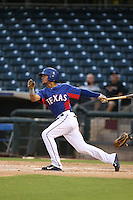 Oliver Caraballo #28 of the AZL Rangers bats against the AZL Cubs at Surprise Stadium on July 6, 2014 in Surprise, Arizona. AZL Rangers defeated the AZL Cubs, 7-5. (Larry Goren/Four Seam Images)