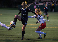 Seattle, WA - Saturday March 24, 2018: Beverly Yanez, Tori Huster during a regular season National Women's Soccer League (NWSL) match between the Seattle Reign FC and the Washington Spirit at the UW Medicine Pitch at Memorial Stadium.