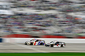 Monster Energy NASCAR Cup Series<br /> Folds of Honor Quik Trip 500<br /> Atlanta Motor Speedway, Hampton, GA USA<br /> Sunday 25 February 2018<br /> Kyle Busch, Joe Gibbs Racing, Snickers Almond Toyota Camry and Kevin Harvick, Stewart-Haas Racing, Jimmy John's Ford Fusion<br /> World Copyright: Nigel Kinrade<br /> NKP / LAT Images