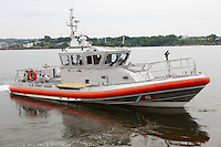 US Coast Guard Response Boat-Medium (RB-M) departs after helping a stranded boater