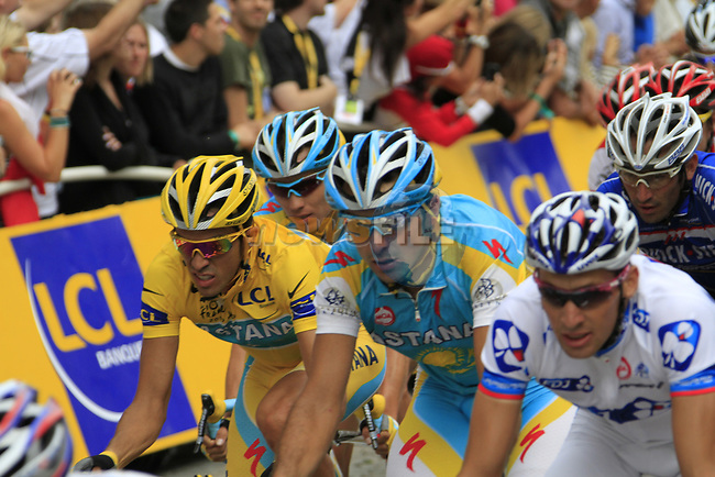 The peloton including Yellow Jersey leader Alberto Contador (ESP) Astana on the Champs-Elysees during the final Stage 20 of the 2010 Tour de France running 102.5km from Longjumeau to Paris Champs-Elysees, France. 25th July 2010.<br /> (Photo by Eoin Clarke/NEWSFILE).<br /> All photos usage must carry mandatory copyright credit (© NEWSFILE | Eoin Clarke)