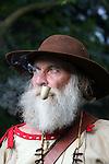 A buckskin Mountain Man smoking a pipe