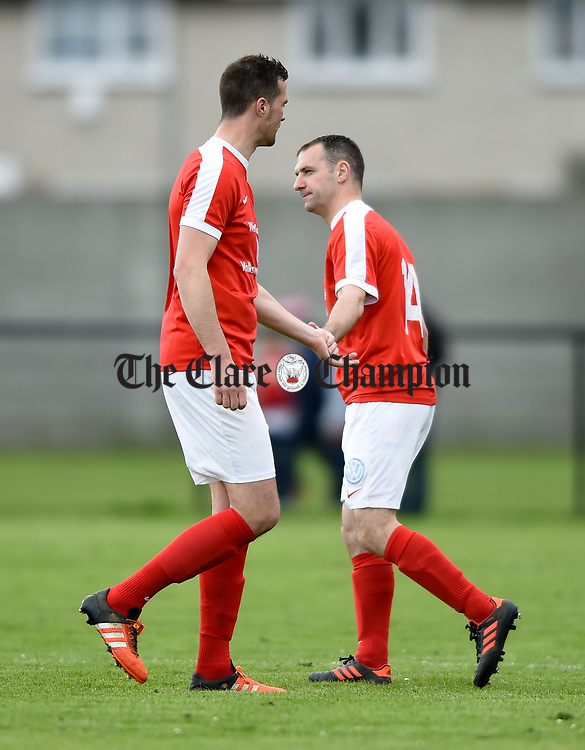 An injured Stephen Kelly of Newmarket is replaced by Seamus Lawlor during their Munster Junior Cup semi-final at Limerick. Photograph by John Kelly.