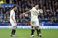 Andre Ayew celebrates scoring his sides second goal with Neil Taylor and Ki Sung-Yueng during the Barclays Premier League match between Everton and Swansea City played at Goodison Park, Liverpool. 1-2