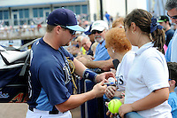 Tampa Bay Rays catcher Stephen Vogt #26 signs autographs before a Grapefruit League Spring Training game against the Boston Red Sox at Charlotte County Sports Park on February 25, 2013 in Port Charlotte, Florida.  Tampa Bay defeated Boston 6-3.  (Mike Janes/Four Seam Images)