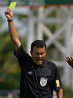 Referee, yellow card, Argentina vs. USA, Miami, Fla.