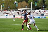 CARY, NC - APRIL 10: Ashley Hatch #33 of the Washington Spirit and Merritt Mathias #11 of the NC Courage fight for position during a game between Washington Spirit and North Carolina Courage at Sahlen's Stadium at WakeMed Soccer Park on April 10, 2021 in Cary, North Carolina.