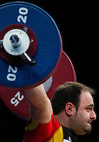 11 DEC 2011 - LONDON, GBR - Almir Velagic (GER) lifts during the men's +105kg category Snatch during the London International Weightlifting Invitational and 2012 Olympic Games test event held at the ExCel Exhibition Centre in London, Great Britain .(PHOTO (C) NIGEL FARROW)