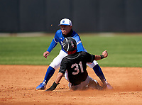 IMG Academy Ascenders shortstop Stone Russell (13) tags Rafeal Moreno (31) sliding into second base during a game against the Lakeland Dreadnaughts on February 20, 2021 at IMG Academy in Bradenton, Florida.  (Mike Janes/Four Seam Images)