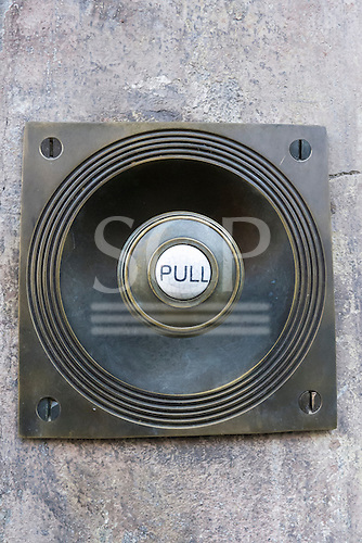 Spitalfields, London. Old-fashioned manual wire operated bell pull at front door of a Georgian house.
