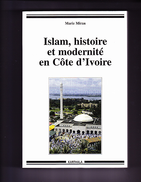 Abidjan, Cote d'Ivoire, Ivory Coast.  Riviera Mosque.  Worshippers leaving the mosque after the Eid al-Adha prayers. Book cover. IMAGE OF COVER IS NOT FOR SALE.  Shown here as examples of photographer's portfolio.  Original images may be licensed for certain purposes.  Please inquire.