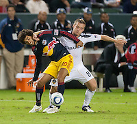CARSON, CA - November 3, 2011: NY Red Bull midfielder Mehdi Ballouchy (10) and LA Galaxy midfielder Chris Birchall (8) during the match between LA Galaxy and NY Red Bulls at the Home Depot Center in Carson, California. Final score LA Galaxy 1, NY Red Bulls 0.