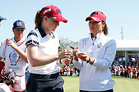 5th September 2021; Toledo, Ohio, USA;  Austin Ernst and Danielle Kang of Team USA autograph a golf ball after their win on the 18th hole during the morning Four-Ball Pairings during the Solheim Cup on September 5th