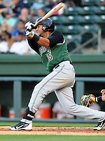 Second baseman Jose Cuevas (15) of the Augusta GreenJackets, a San Francisco Giants affiliate, in a game against the Greenville Drive on April 19, 2012, at Fluor Field at the West End in Greenville, South Carolina. (Tom Priddy/Four Seam Images)
