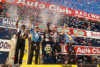 Nov 13, 2016; Pomona, CA, USA; (From left) NHRA top fuel driver Antron Brown , funny car driver Ron Capps , pro stock driver Jason Line and pro stock motorcycle rider Jerry Savoie celebrate after winning the 2016 world championships following the Auto Club Finals at Auto Club Raceway at Pomona. Mandatory Credit: Mark J. Rebilas-USA TODAY Sports