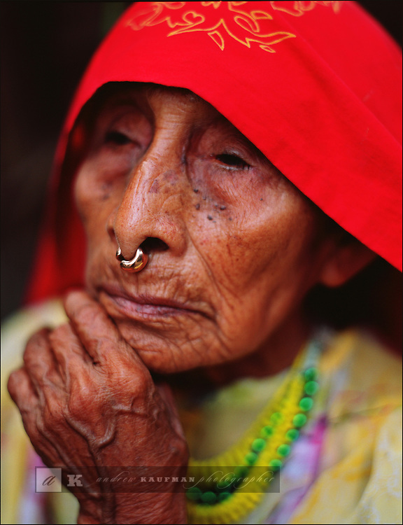 A traditional Kuna Indian woman on Isla Ailitup. She is adorned in traditional Kuna head dress and nose ring...In Panama's Carribean archipelago Kuna Yala there are three hundred and fifty isles. There are said to be 65.000 Kuna Indians. The live across the islands. The islands are autonomous and live according to their own laws not Panama's. The Kuna elders are named Shilah's...