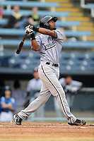 Kannapolis Intimidators center fielder Ruben Sierra Jr. #18 swings at a pitch during a game against the Asheville Tourists at McCormick Field on May 10, 2013 in Asheville, North Carolina. The Intimidators won the game 5-2. (Tony Farlow/Four Seam Images).
