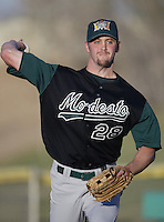 Michael Wood of the Modesto A's warms up before pitching during a California League 2002 season game against the High Desert Mavericks at Mavericks Stadium, in Adelanto, California. (Larry Goren/Four Seam Images)