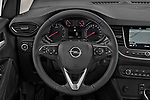 Car pictures of steering wheel view of a 2021 Opel Crossland Edition 5 Door SUV Steering Wheel