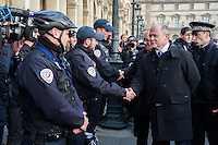 French Interior Minister Bruno Le Roux speaks to police at the Louvre Museum as emergency security measures continue ahead of New Year's eve celebrations in and around the French capital, in Paris, France, December 30, 2016.