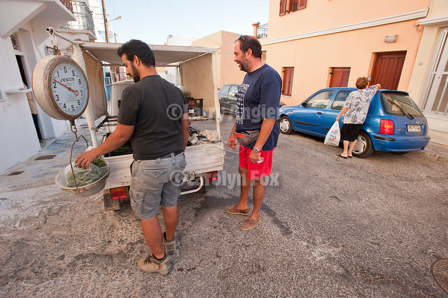 Mobile produce vendor with scale stops for his customers, Ermoupoli, Syros, Cycledes, Greece